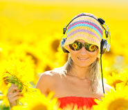 Portrait of beautiful happy woman listening to mus Royalty Free Stock Photo