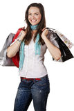 Portrait of a beautiful happy woman out shopping. A lovely portrait of a beautiful happy woman out shopping. Isolated over white Royalty Free Stock Photo