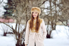 Portrait of a beautiful happy woman in winter park Royalty Free Stock Images