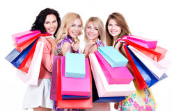 Portrait of beautiful happy women purchasing. Portrait of beautiful happy women purchasing standing on a white background Royalty Free Stock Image