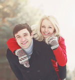 Portrait of a beautiful happy young couple in love. On a sunny day in winter Stock Photo