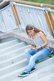 Portrait of Beautiful, happy young girl with smartphone Royalty Free Stock Photos