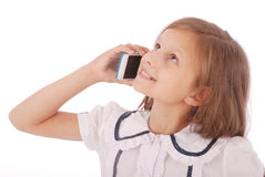 Portrait of beautiful happy young girl talking on smartphone Stock Photos