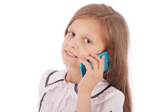Portrait of beautiful happy young girl talking on smartphone Royalty Free Stock Image