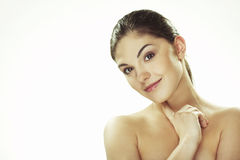 Portrait of beautiful happy young woman. A happy young woman with facial expression on white background Stock Photo