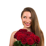 Portrait of a beautiful happy young woman with a big bouquet of flowers Stock Photos