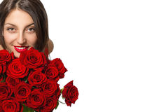 Portrait of a beautiful happy young woman. Portrait of a beautiful happy young woman with a bouquet of red roses on a white background Royalty Free Stock Images