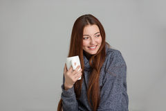 Portrait of beautiful happy young woman holding white cup Stock Photo