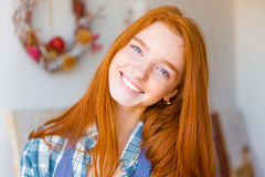 Portrait of beautiful happy young woman with long red hair Stock Photo