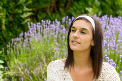 Portrait of beautiful happy young woman outdoors. A portrait of beautiful happy young woman outdoors Stock Image