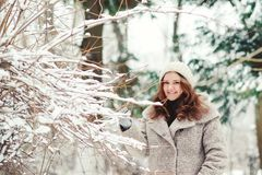 Portrait of beautiful young woman in wintertime in nature. Royalty Free Stock Photos