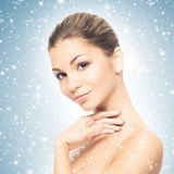 Portrait of a beautiful and healthy girl on the snow Royalty Free Stock Photo