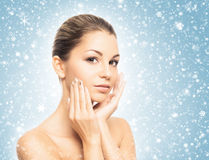 Portrait of a beautiful and healthy girl on the snow Royalty Free Stock Photos