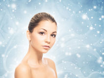 Portrait of a beautiful, healthy and sensual woman on the snow Royalty Free Stock Images