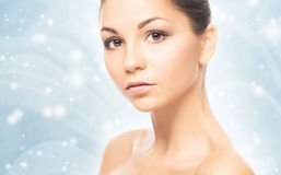 Portrait of a beautiful, healthy and sensual woman on the snow Stock Photography