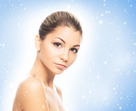 Portrait of a beautiful, healthy and sensual woman on the snow Royalty Free Stock Photos