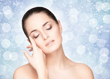 Portrait of a beautiful and healthy woman on a snowy background Royalty Free Stock Photo