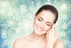 Portrait of a beautiful and healthy woman on a snowy background Stock Image