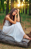 Portrait of beautiful hippie girl sitting on a dry log Royalty Free Stock Photography