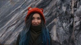 Portrait of a beautiful hipster girl on the background the rocky cliffs. Dyed hair, blue, long. stock footage