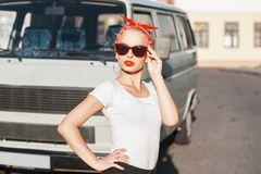 Portrait of a beautiful hipster girl with sunglasses near the ca. R. summer Stock Images