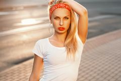 Portrait of a beautiful hipster with red lips at sunset. retro l. Ook summer Royalty Free Stock Photo