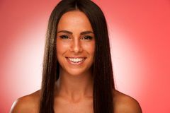 Portrait of Beautiful hispanic woman in ftont of red background Royalty Free Stock Photo