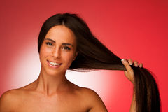 Portrait of Beautiful hispanic woman in ftont of red background Royalty Free Stock Image