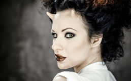 Portrait of beautiful horned woman with bright makeup Royalty Free Stock Photography