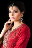 Portrait of a beautiful indian bride. Muslim Indian bride wearing a red bridal dress, portrait of a beautiful Indian bride Royalty Free Stock Images