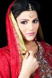 Portrait of a beautiful indian bride. Muslim Indian bride wearing a red bridal dress, portrait of a beautiful Indian bride Royalty Free Stock Photos