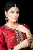 Portrait of a beautiful indian bride. Muslim Indian bride wearing a red bridal dress, portrait of a beautiful Indian bride Royalty Free Stock Photo