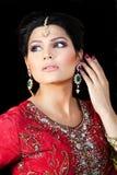 Portrait of a beautiful indian bride. Muslim Indian bride wearing a red bridal dress, portrait of a beautiful Indian bride Royalty Free Stock Image