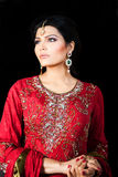Portrait of a beautiful indian bride. Muslim Indian bride wearing a red bridal dress, portrait of a beautiful Indian bride Stock Photography