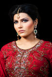 Portrait of a beautiful indian bride. Muslim Indian bride wearing a red bridal dress, portrait of a beautiful Indian bride Stock Photo