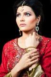 Portrait of a beautiful indian bride. Muslim Indian bride wearing a red bridal dress, portrait of a beautiful Indian bride Royalty Free Stock Photography