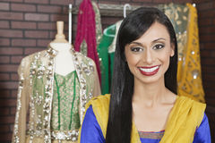 Portrait of a beautiful Indian female dressmaker smiling Stock Photo