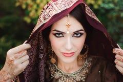 Portrait of beautiful indian girl . Young hindu woman model with tatoo mehndi and kundan jewelry stock images