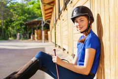 Portrait of beautiful jockey girl at riding stable stock images