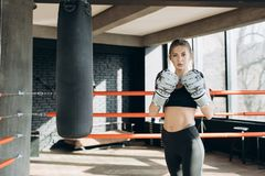 Portrait kickboxing woman fighter looking confident at camera tough female kickboxer fierce sportswoman sweating after stock photos