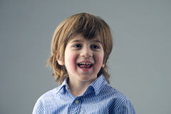 Portrait of a beautiful kid laughing isolated Royalty Free Stock Photos