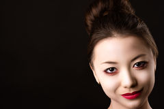 Portrait beautiful Korean girl closeup with bright makeup. Isolated on black background Stock Image