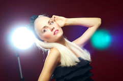 Portrait of the beautiful lady. On red Stock Photo