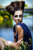 Portrait of the beautiful lady. Beautiful lady with an improbable hairdress royalty free stock photography