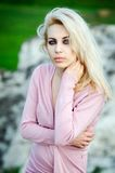 Portrait of the beautiful lady. Beautiful young woman posing over picturesque landscape Royalty Free Stock Image
