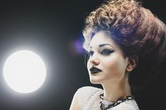 Portrait of a beautiful lady. With an improbable hairdress Stock Images