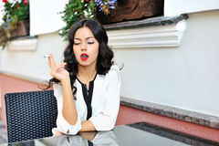 Portrait of a beautiful lady with cigarette royalty free stock photography