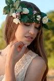 Portrait of beautiful lady in floral wreath, outdoor, style of s. Pring and summer Stock Photos