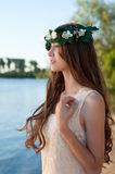 Portrait of beautiful lady in floral wreath. Outdoor, style of spring and summer Royalty Free Stock Photos