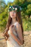 Portrait of beautiful lady in floral wreathsitting Royalty Free Stock Photo